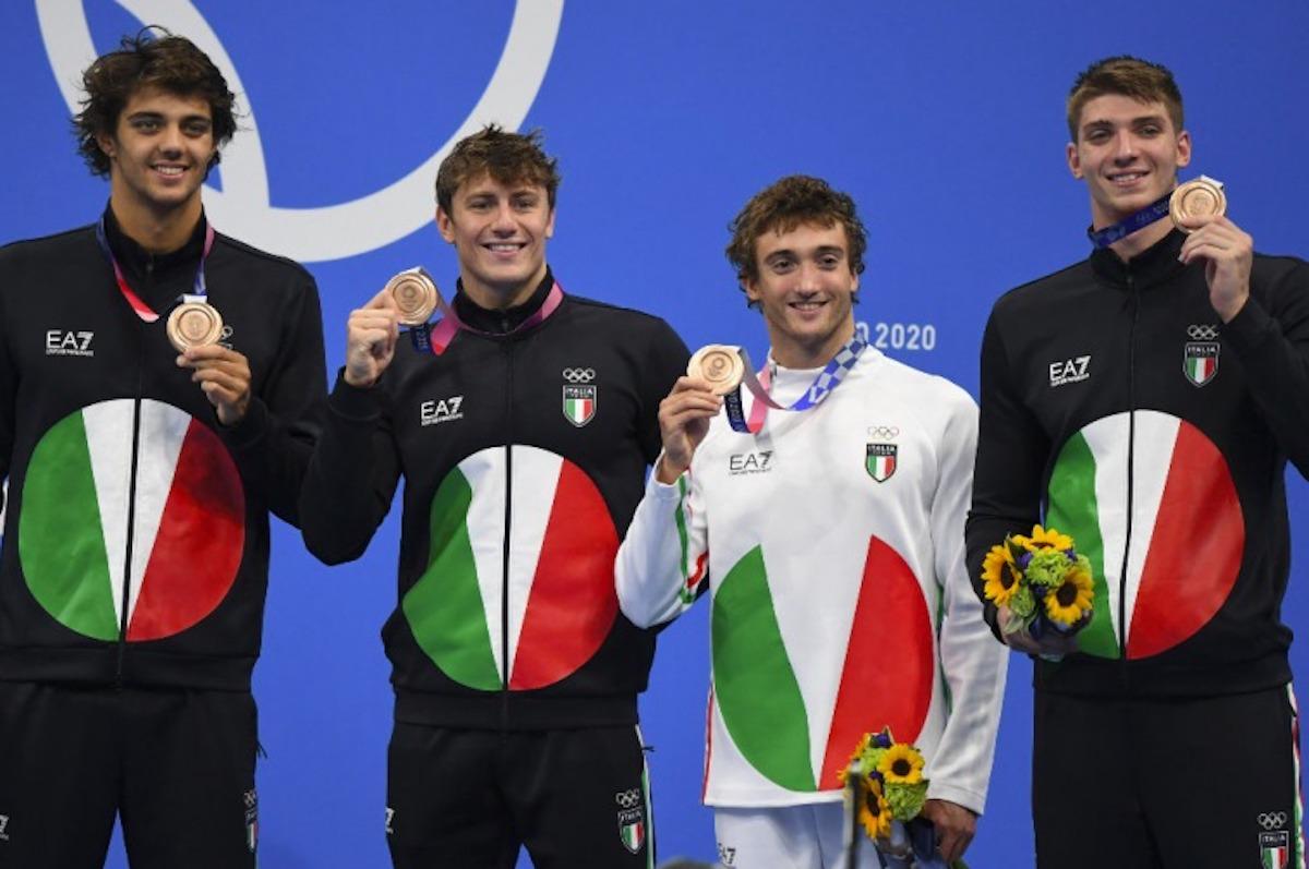 perché atleti mordono medaglia